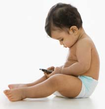Mixed race baby boy looking at cell phone